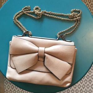 Adorable blush colored bow purse
